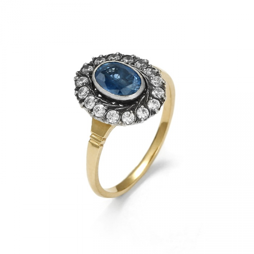 Gold ring with natural sapphire and zircons
