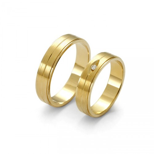 Złota obrączka z brylantem lub cyrkonią
