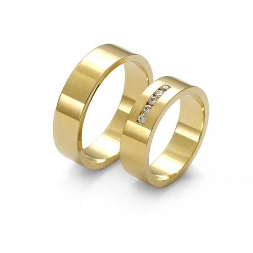 Szeroka złota obrączka z brylanami
