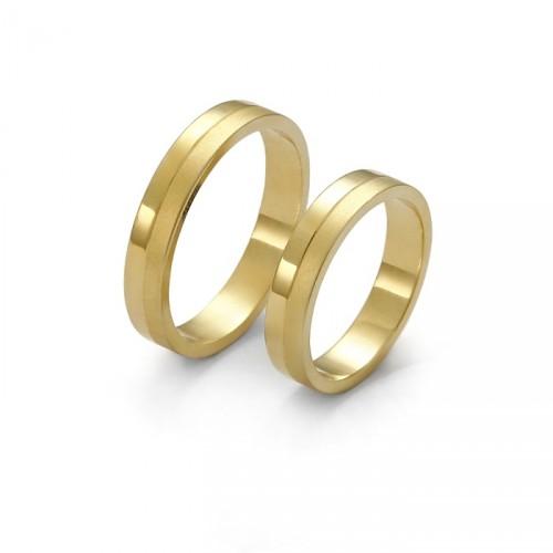 Złota obrączka sytanowana po jednej stronie